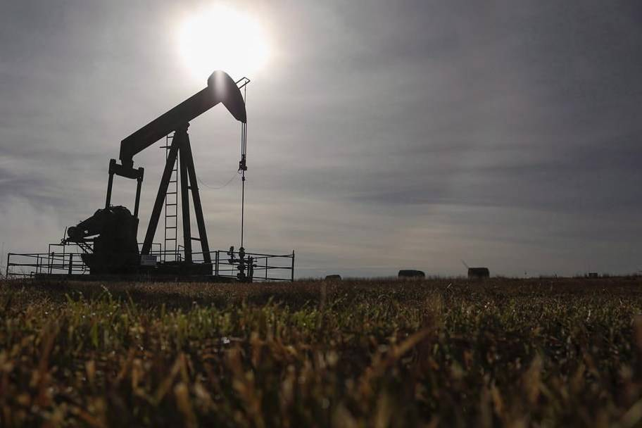 A pumpjack works at a wellhead on an oil and gas installation near Cremona, Alta., Saturday, Oct. 29, 2016. THE CANADIAN PRESS/Jeff McIntosh