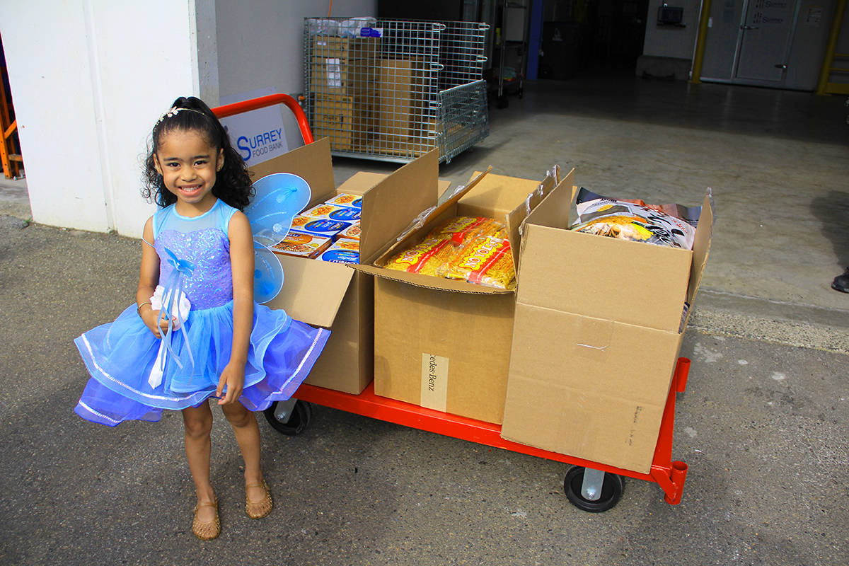 Sierra Sequeira stands with 250 pounds of pasta that the four-year-old raised for the Surrey Food Bank. For her birthday this year, Sierra asked for donations for the food bank instead of gifts. (Photo: Malin Jordan)