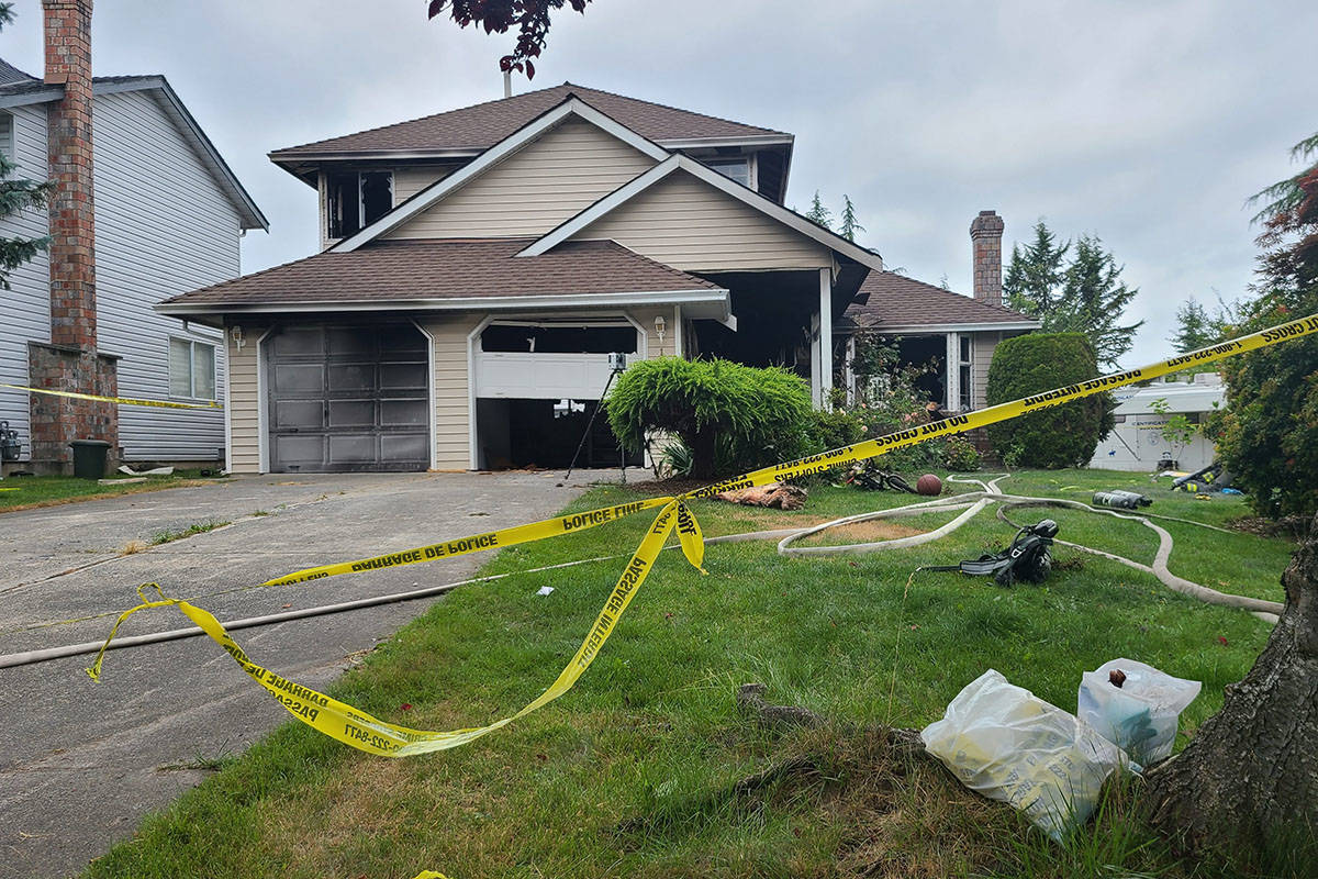 A Surrey home sits behind police tape after the body of a five-year-old child was found in the burned out home. (Aaron Hinks photo)