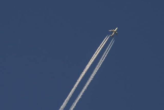 An airliner cuts through the skies over Montreal, Wednesday, Dec. 23, 2020/ Low-cost carrier Flair Airlines is expanding into the U.S. market. THE CANADIAN PRESS/Paul Chiasson