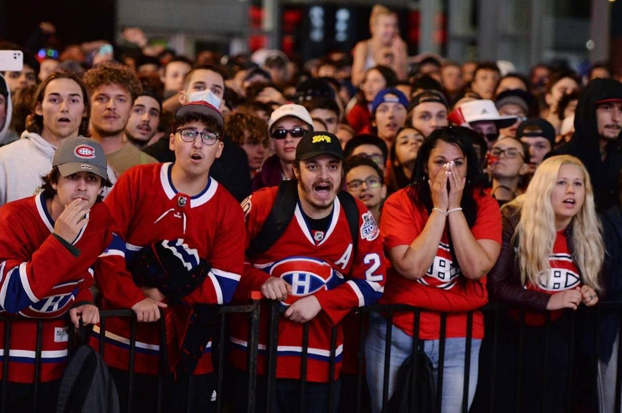 Montreal Canadiens fans react as they watch Game 5 Stanley Cup finals action against the Tampa Bay Lightning on a big screen outside of the Bell Centre in Montreal, Wednesday, July 7, 2021. THE CANADIAN PRESS/Ryan Remiorz
