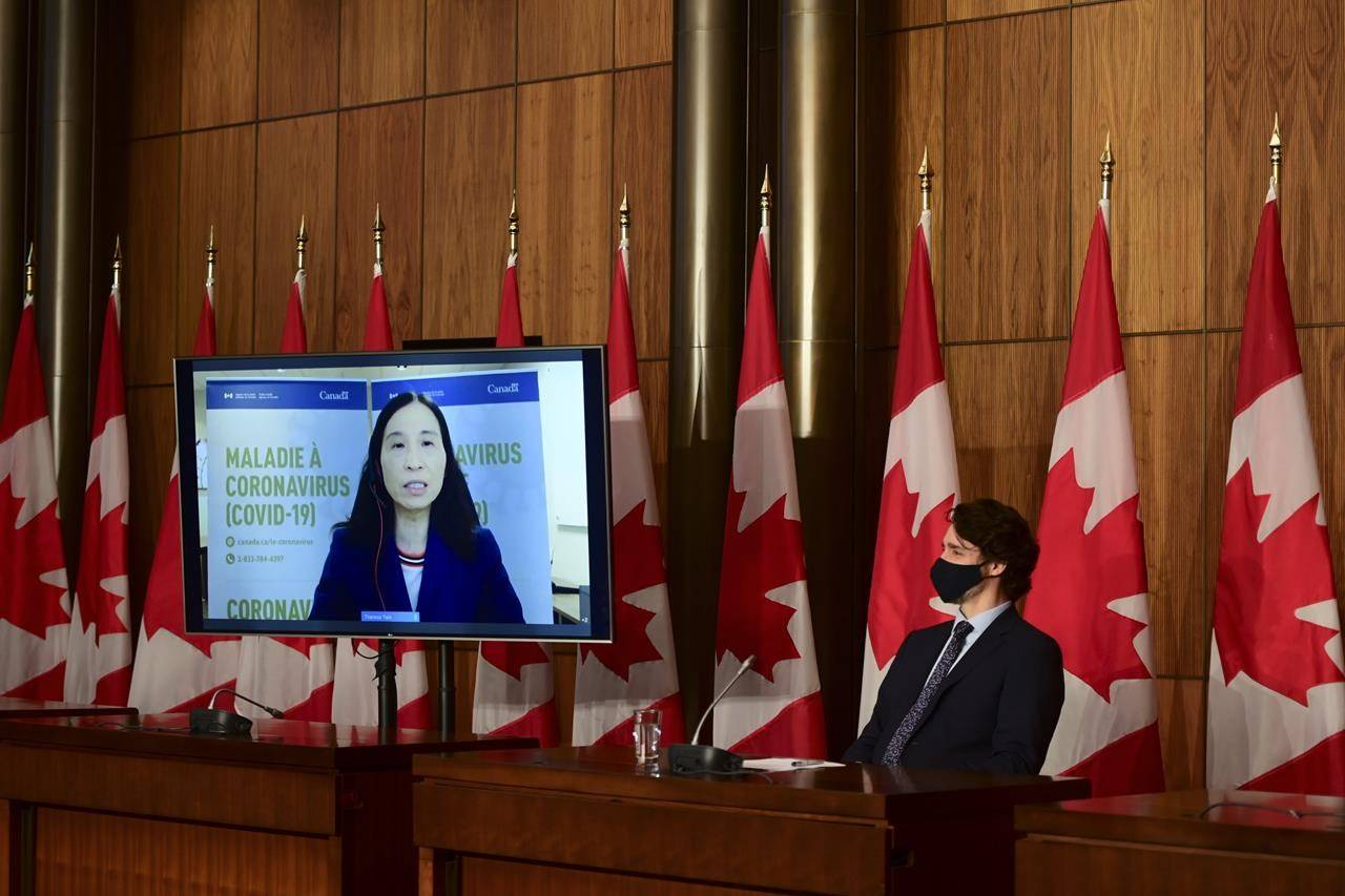 Chief Public Health Officer Dr. Theresa Tam speaks virtually as Prime Minister Justin Trudeau looks on during a press conference in Ottawa on Friday, May 7, 2021. THE CANADIAN PRESS/Sean Kilpatrick