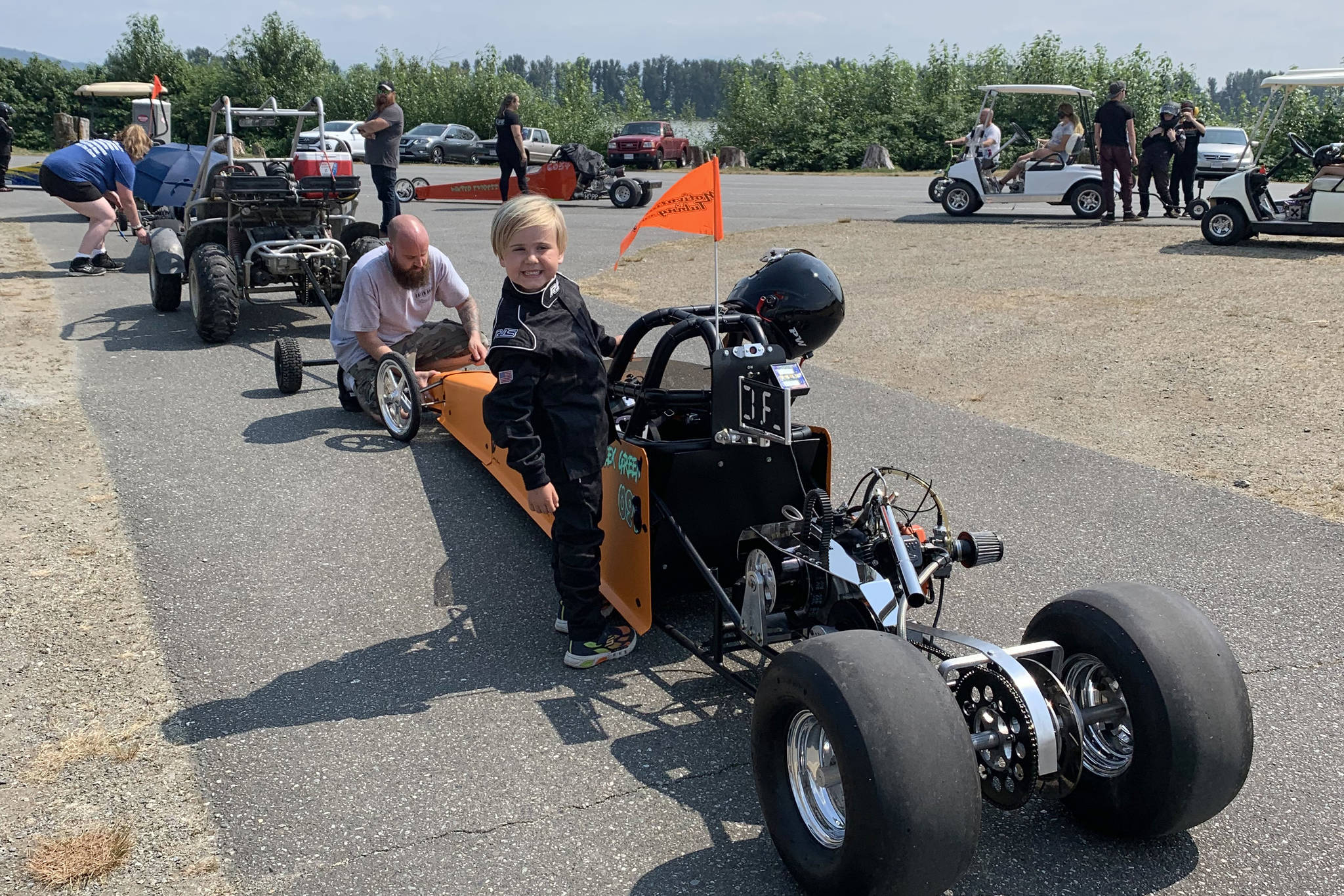 Alex Green and his father with their junior dragster at the Mission Raceway Park's Doorwarz event last weekend. Green won his first-ever race on Saturday, and was runner up in Sunday's race. Submitted photo.