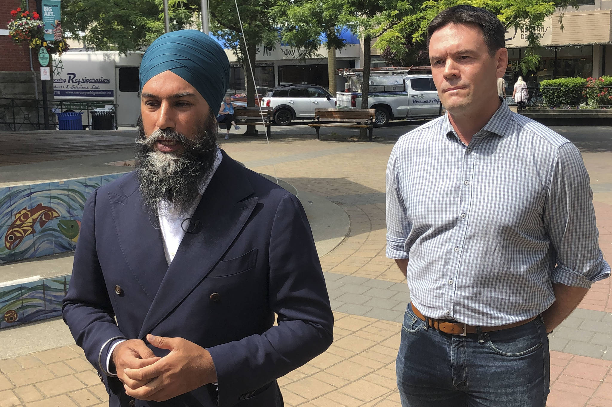 Federal NDP leader Jagmeet Singh and Cowichan-Malahat-Langford MP Alistair MacGregor speak with the media in Duncan, B.C. on Thursday, July 8. (Kevin Rothbauer/Citizen)