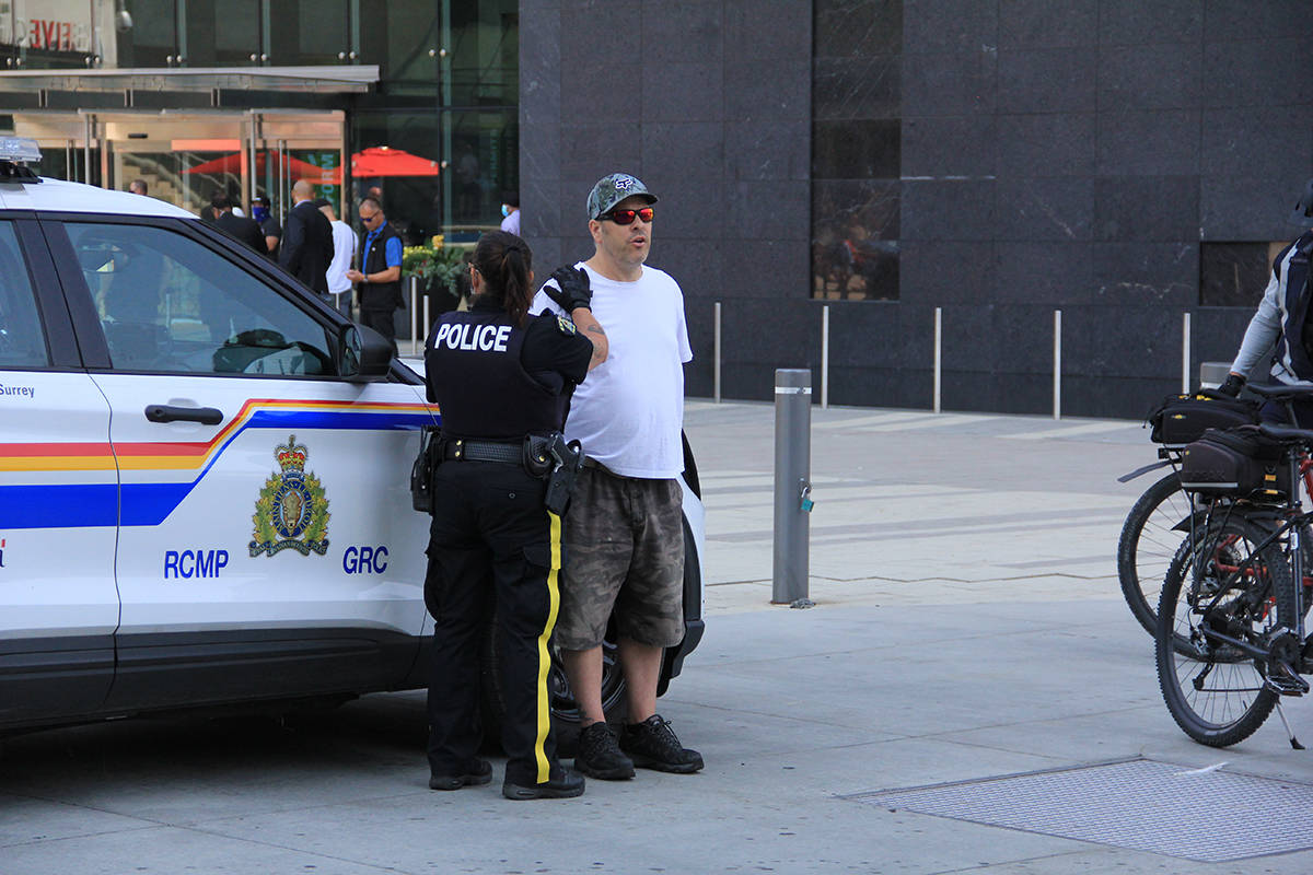 At least two people were arrested at City Hall during the announcement. One man, pictured, would not give his name and was not cooperating with police. (Malin Jordan/Black Press Media)
