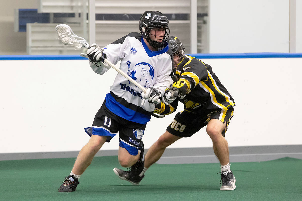 Langley Junior Thunder's Cooper Gettel gets a step on his Port Coquitlam Saints opponent during BCJALL action at Langley Events Centre on July 8. The visiting Saints prevailed 14-3. (Photo courtesy of Damon James/Langley Events Centre)