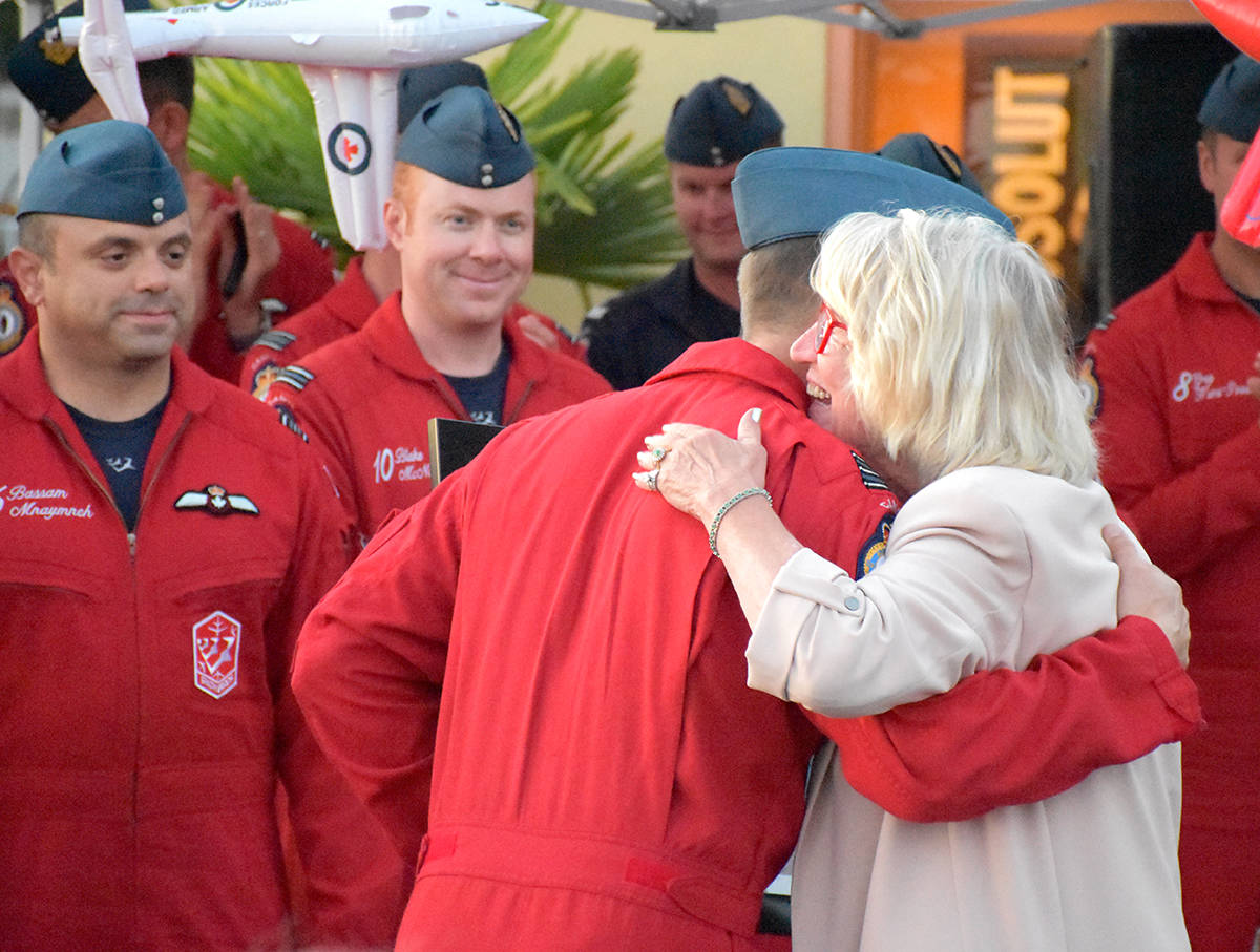 Snowbirds pilot Mike French gives Mary McCarthy Parsons a hug after the Snowbirds annual flight over White Rock for the CH.I.L.D Foundation Wednesday evening. (File photo)