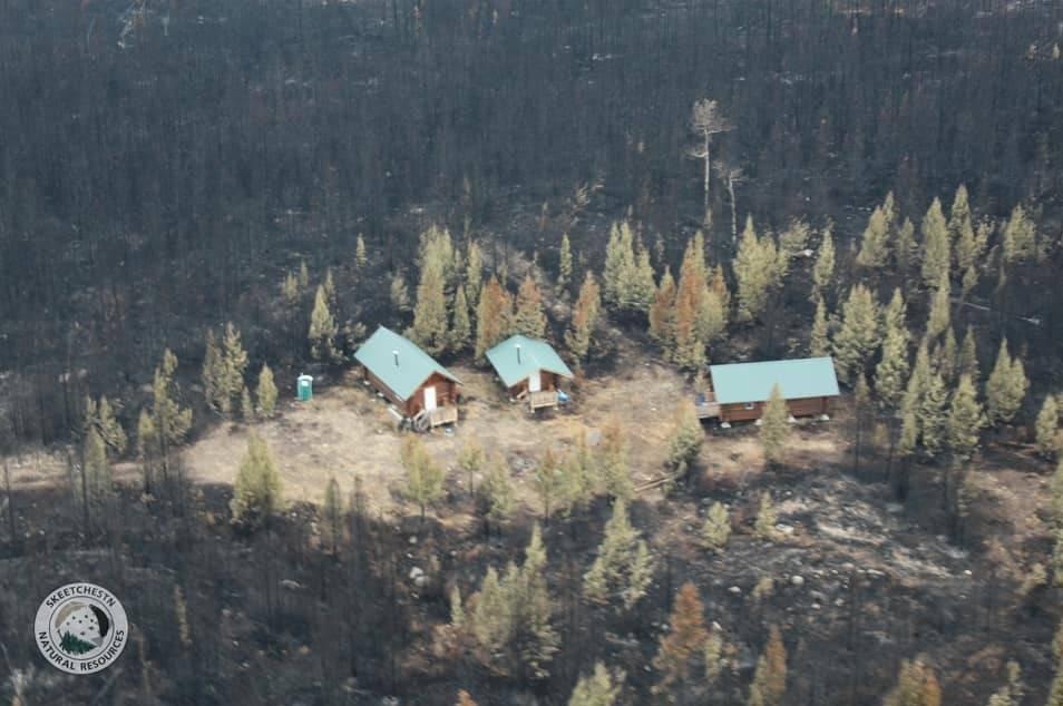Skeetchestn cabins at Marshy Lake survive Sparks Lake wildfire on July 8, 2021. (Skeetchestn Natural Resources)