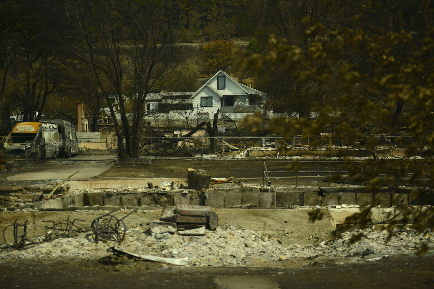 A house stands unscathed in Lytton, B.C. on Friday, July 9, 2021, nine days after a wildfire ripped through the village on June 30, 2021. (Jenna Hauck/ Black Press Media)
