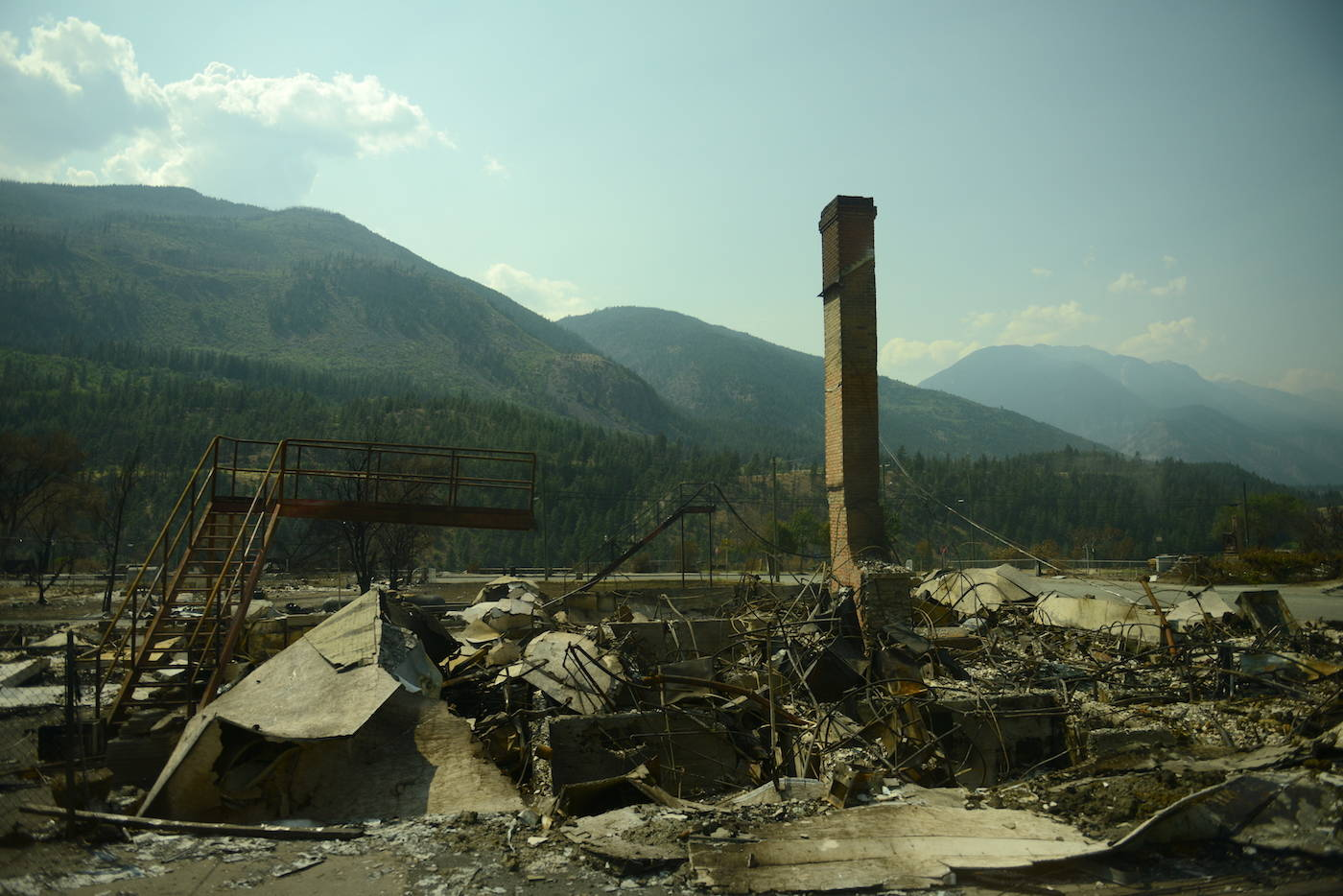 A chimney stands amid debris in Lytton, B.C. on Friday, July 9, 2021, nine days after a wildfire ripped through the village on June 30, 2021. (Jenna Hauck/ Black Press Media)