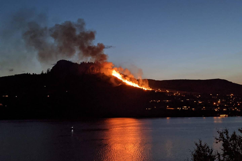 A fire burns on a hillside off Highway 97 near Coldstream on Friday, July 9. (Pamela Pereira Marcelino/Facebook)