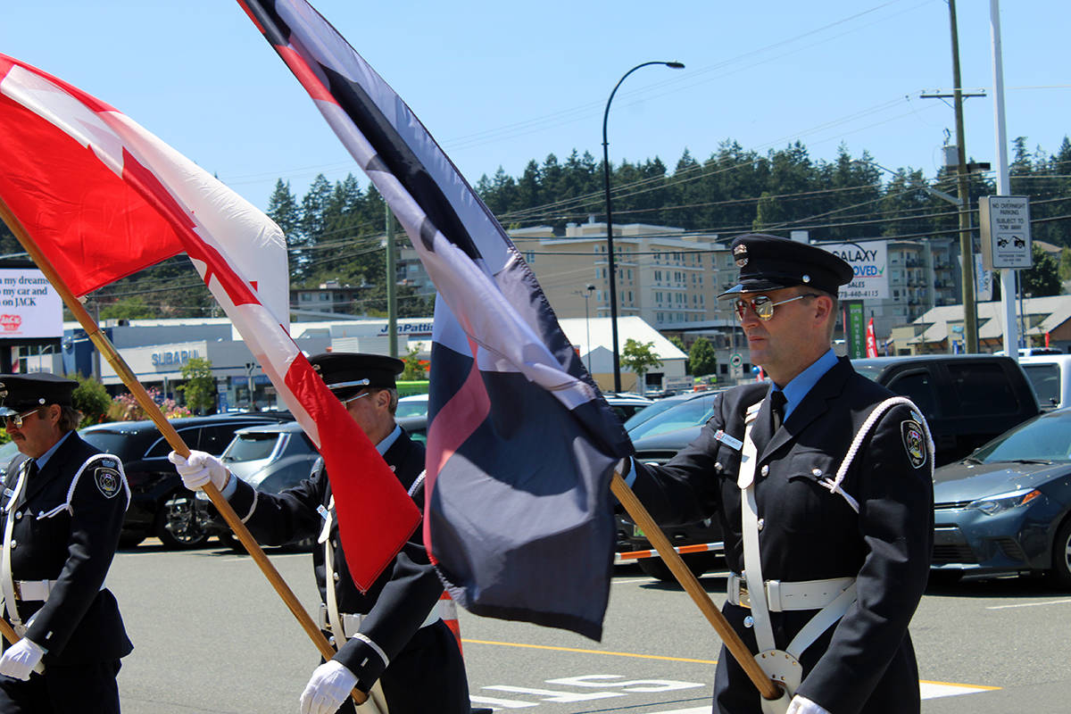 Marching with flags in honour of John Cassidy's service at Colwood Fire