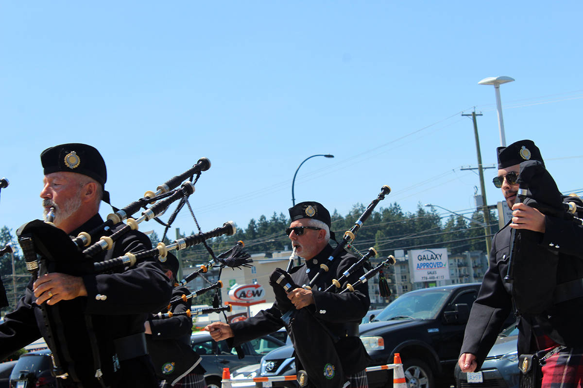 Bagpipes fill the air as many in Greater Victoria honour the late John Cassidy. (Megan Atkins-Baker)