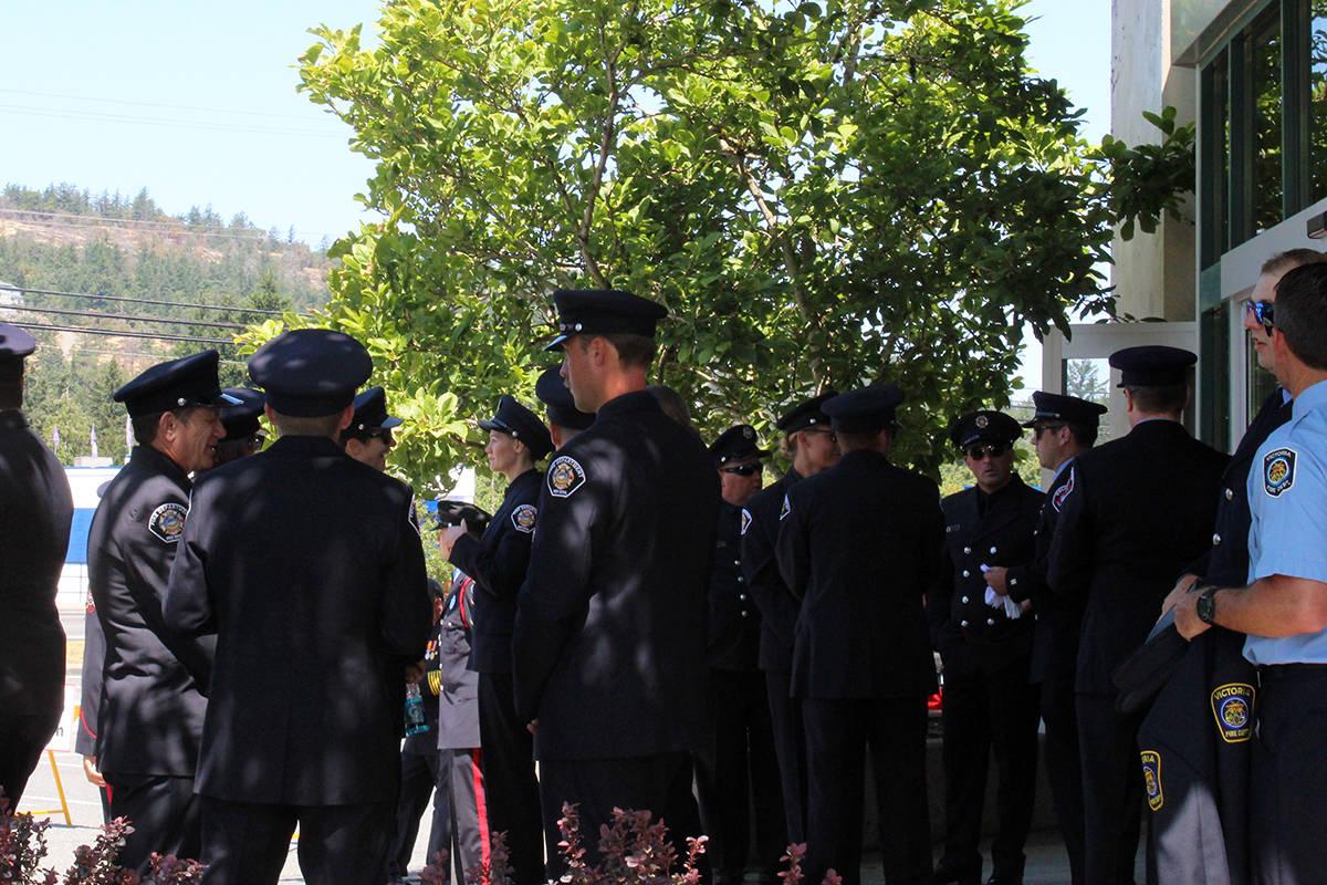 Members of enforcement gather together before service begins. (Megan Atkins-Baker/News Staff)