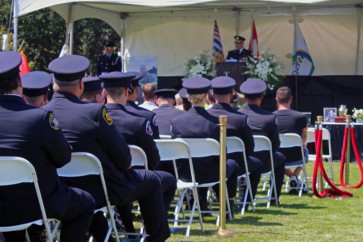 Members of enforcement listen to a speech that honours the late John Cassidy, where a variety of funny, heartfelt and heroic memories are shared. (Megan Atkins-Baker/News Staff)