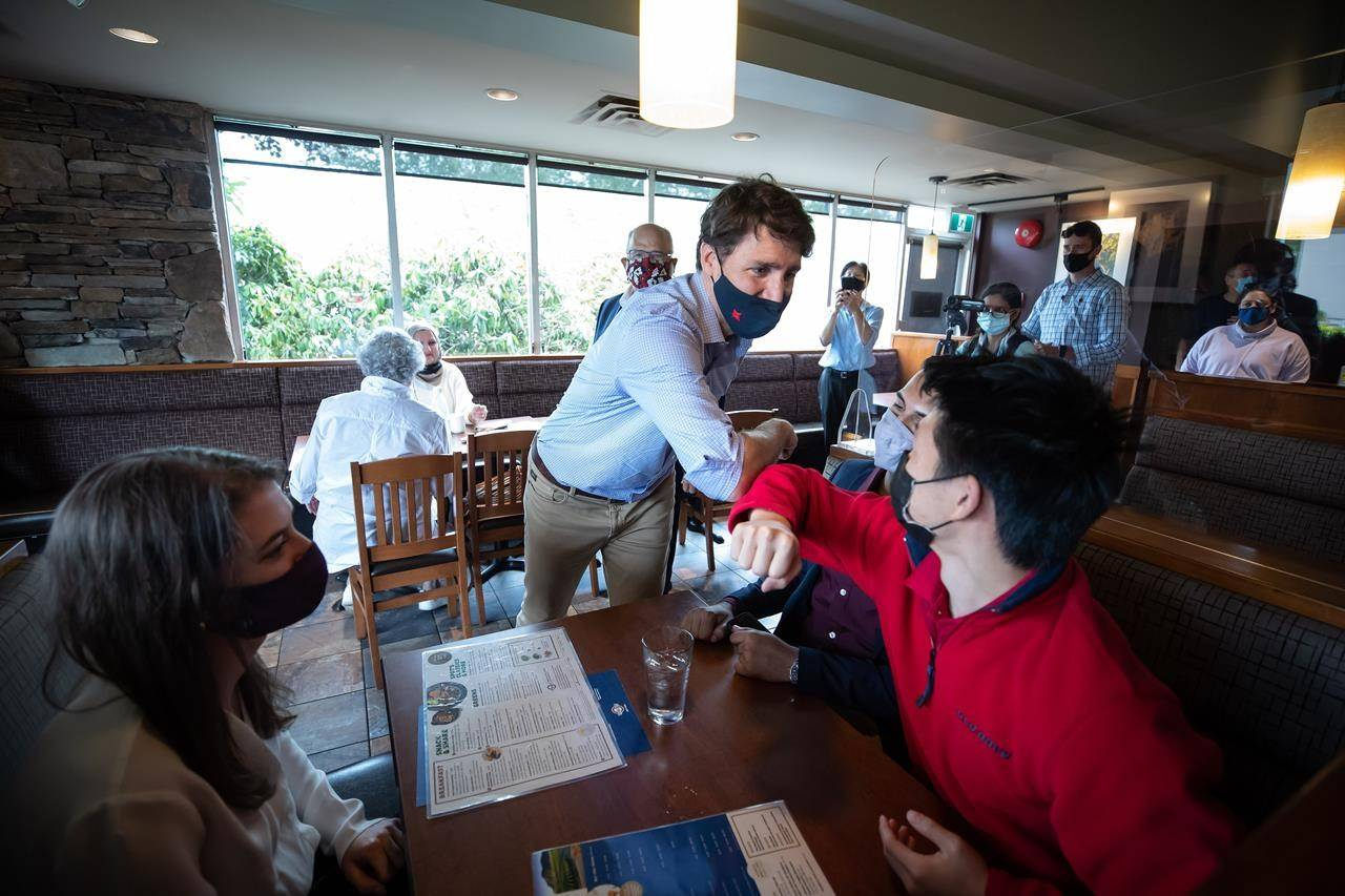 Prime Minister Justin Trudeau greets people having lunch at a White Spot restaurant in Coquitlam, B.C., on Thursday, July 8, 2021. Canadian party leaders worked their way around the country this week, in what some see as the proof they needed that a federal election is on its way. THE CANADIAN PRESS/Darryl Dyck