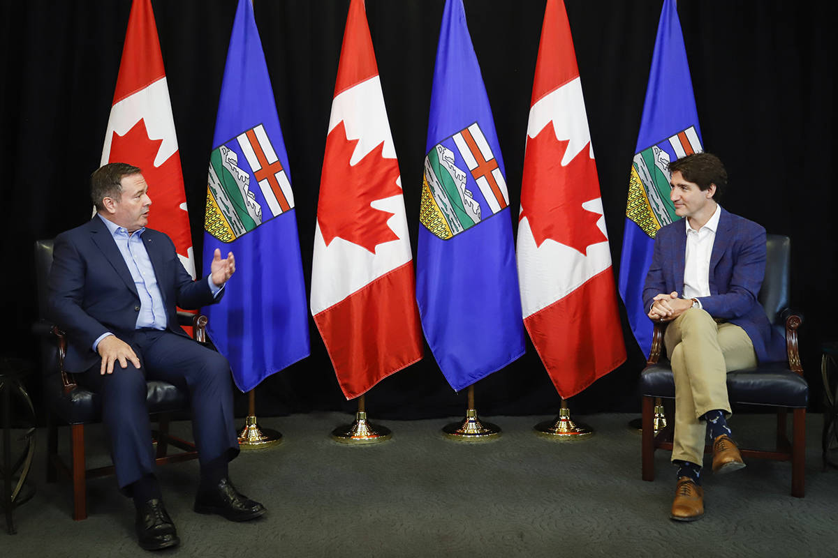 Prime Minister Justin Trudeau, right, meets with Alberta Premier Jason Kenney in Calgary, Alta., Wednesday, July 7, 2021. THE CANADIAN PRESS/Jeff McIntosh