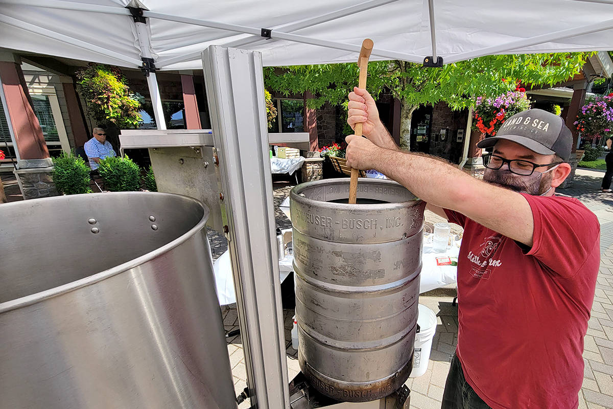 Nathaniel Senff demonstrated proper stirring technique at a beer making demonstration for senior residents of Avalon Gardens in Murrayville on Saturday, July 11. (Dan Ferguson/Langley Advance Times)