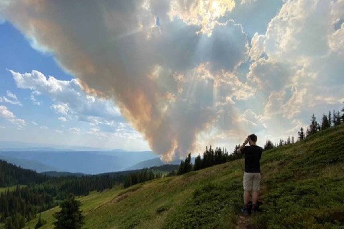 Smoke from the fire near Whitecroft as seen from the trails of Sun Peaks, captured in this photo posted to social media by Twitter user Clientric.
