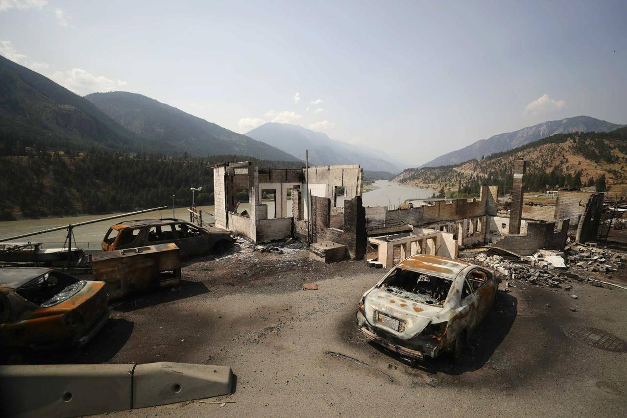Damaged structures and vehicles are seen in Lytton, B.C., Friday, July 9, 2021, after a wildfire destroyed most of the village on June 30. RCMP have set up three security checkpoints around Lytton, B.C., after residents were forced to escape a fast-moving wildfire that destroyed most of the village. THE CANADIAN PRESS/Darryl Dyck