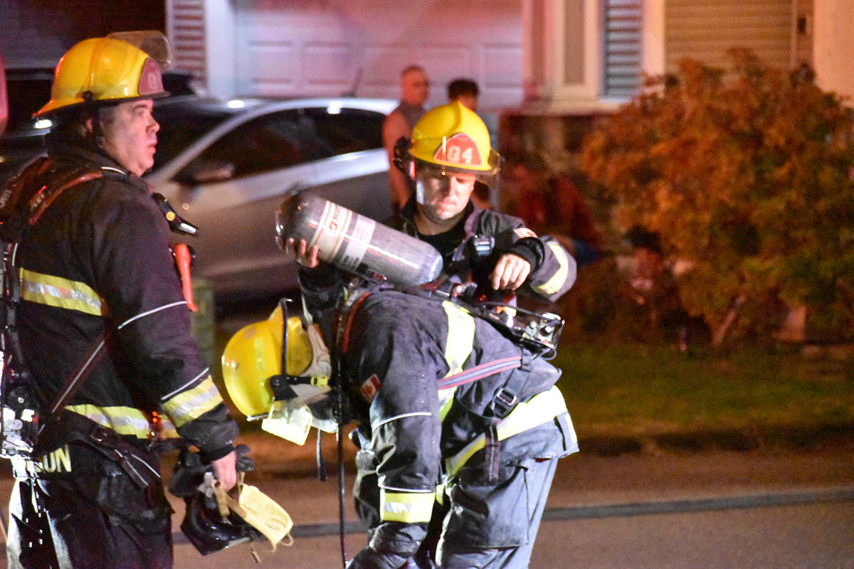 A Willoughby family was rescued from the roof of their home by firefighters early Monday morning. (Curtis Kreklau South Fraser News Services/special to Langley Advance Times)