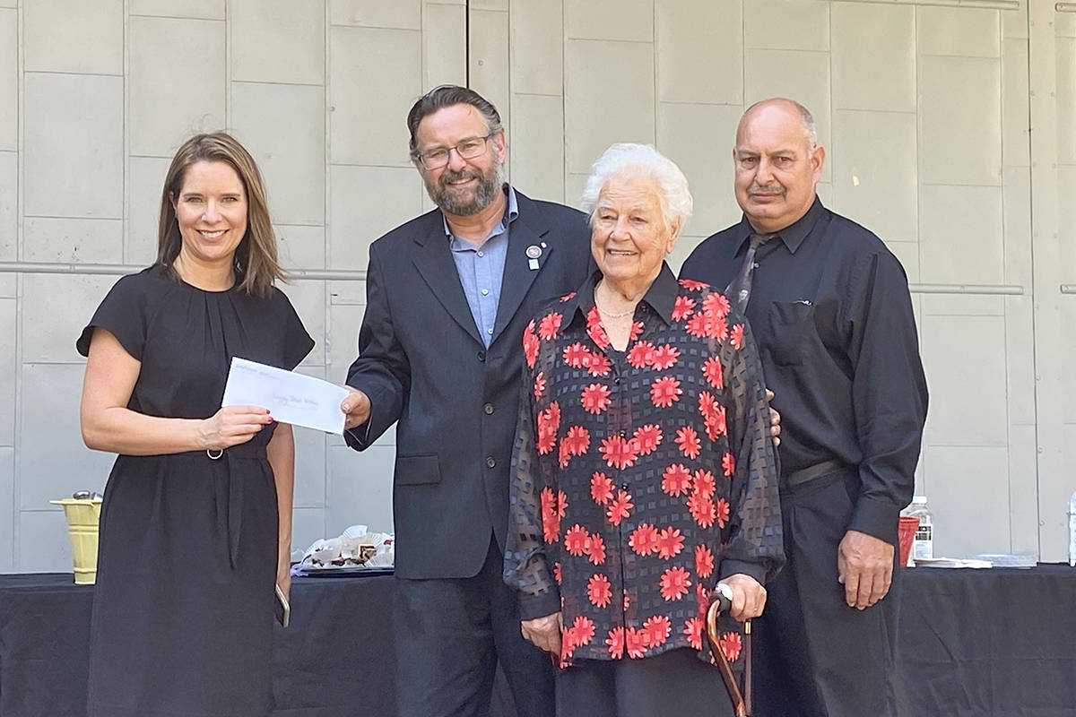 Alicia Rempel, new executive director of the Langley School District Foundation, received a donation from the Camparmo family, Maurizio, and Remi, and their mother, Agnes. It will be used for students going into education. (Lisa Farquharson/Langley Advance Times)