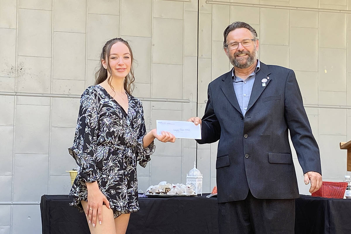 Addison Waller received a scholarship from Dino Camparmo's brother, Maurizio Camparmo. (Lisa Farquharson/Langley Advance Times)