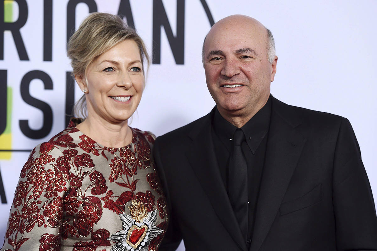 FILE – Linda O'Leary and Kevin O'Leary arrive at the American Music Awards at the Microsoft Theater in Los Angeles. A lawyer for Linda O'Leary, the wife of celebrity businessman Kevin O'Leary, says his client was not impaired when she got involved in a boat crash on an Ontario lake that left two people dead. THE CANADIAN PRESS/AP, Jordan Strauss/Invision