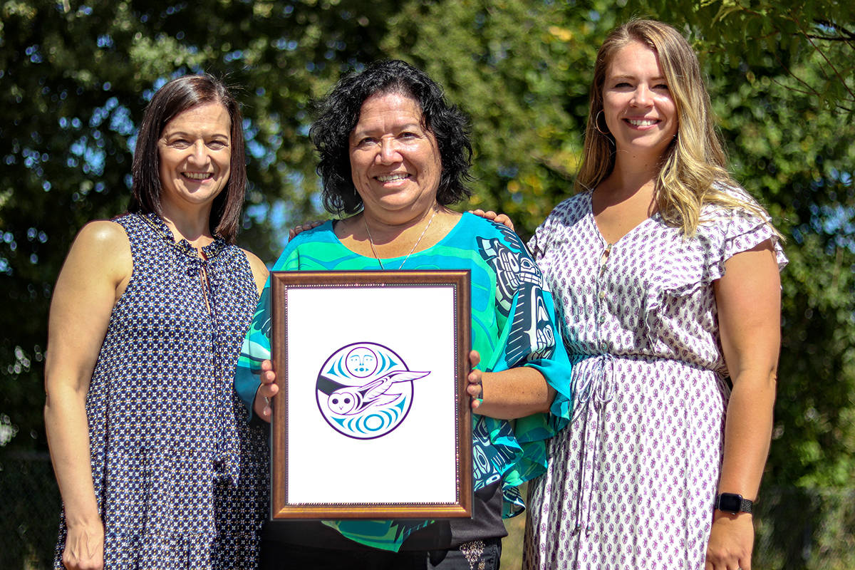 Phillis Giovani, principal of Donna Gabriel Robins Elementary, with Donna Gabriel Robins and Jennifer Huber, vice-principal, unveil the school's owl logo. The new school will open this September. (Special to Langley Advance Times)