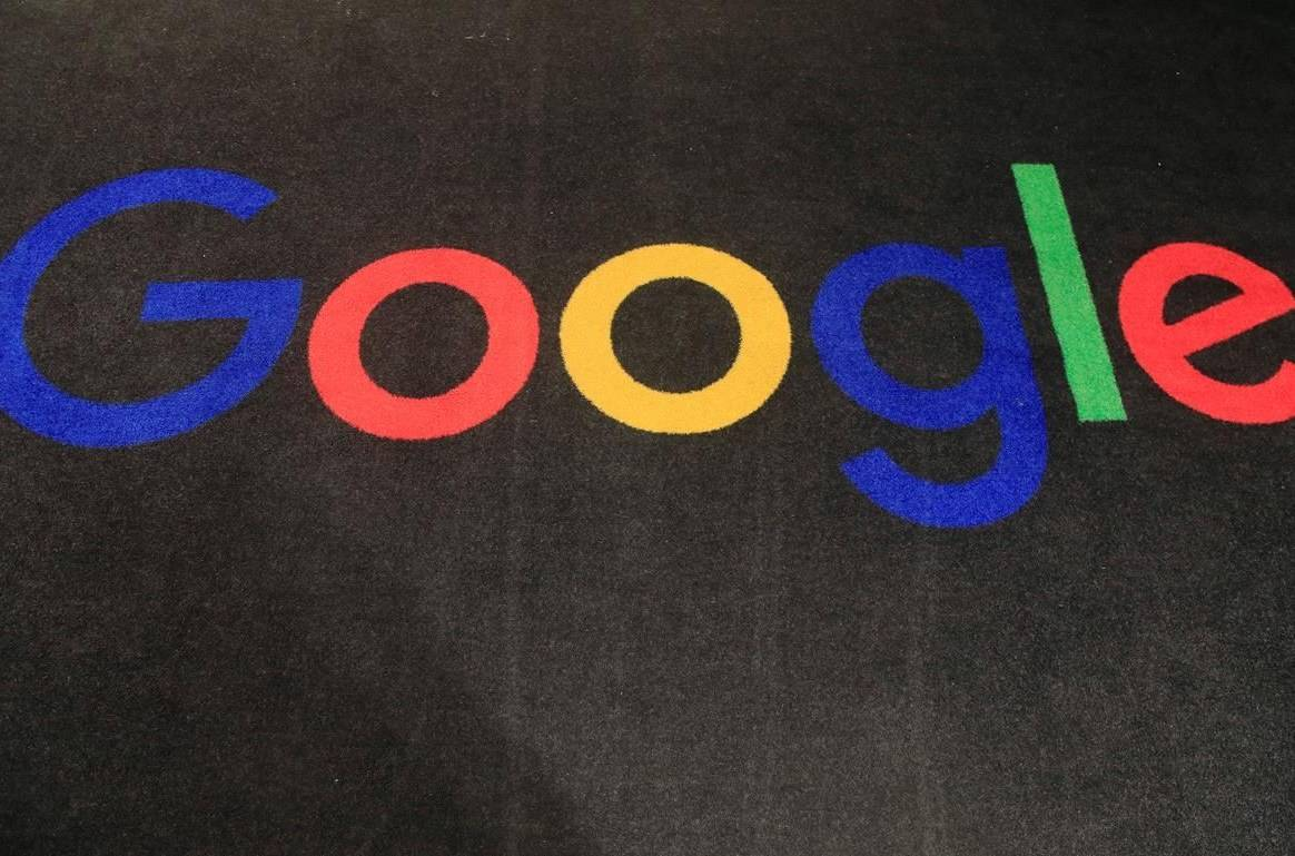 FILE - In this Nov. 18, 2019, file photo, the logo of Google is displayed on a carpet at the entrance hall of Google France in Paris. THE CANADIAN PRESS/AP-Michel Euler