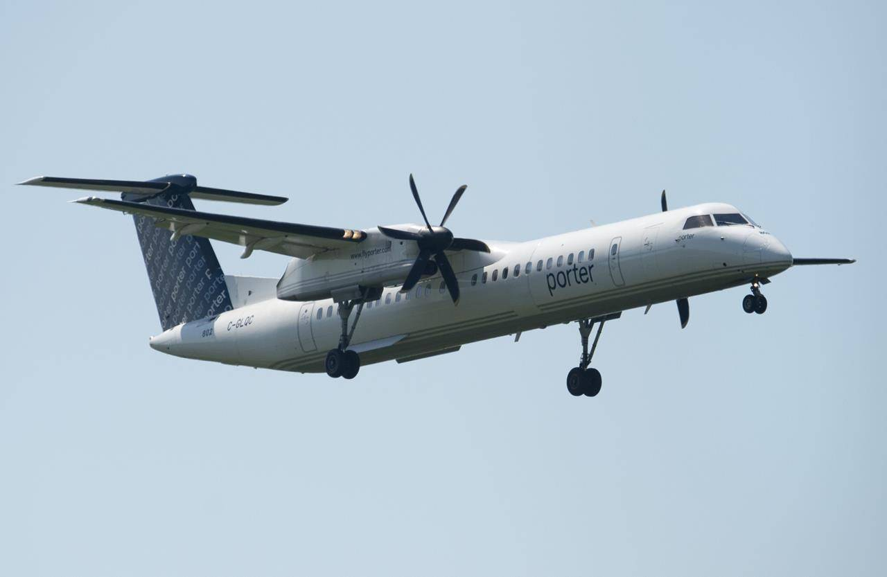 A Porter airlines flight makes its final approach as it lands at the airport Tuesday July 2, 2019 in Ottawa. THE CANADIAN PRESS/Adrian Wyld