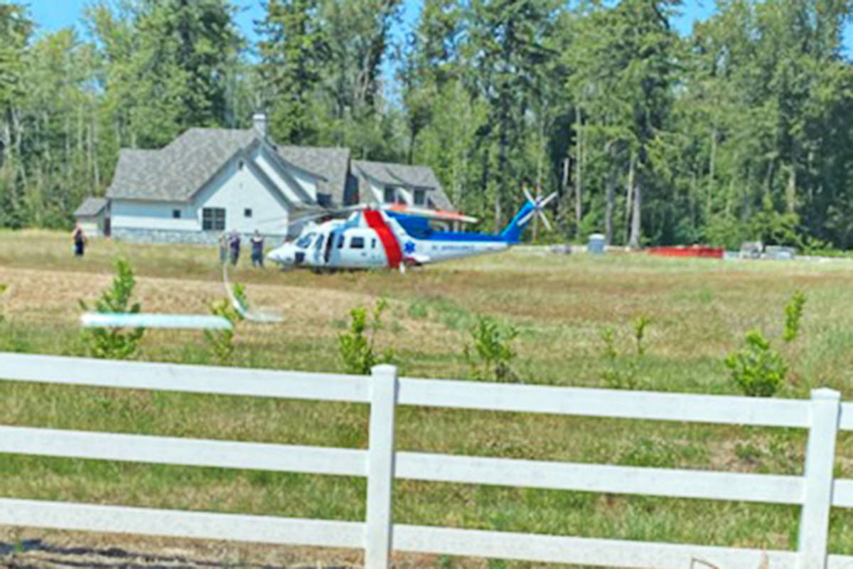 Letter writer Neil Kinsofer took this photo of a medivac helicopter in a neighbour's field after a crash Friday, July 9, 2021, in an area he said is notorious for crashes.