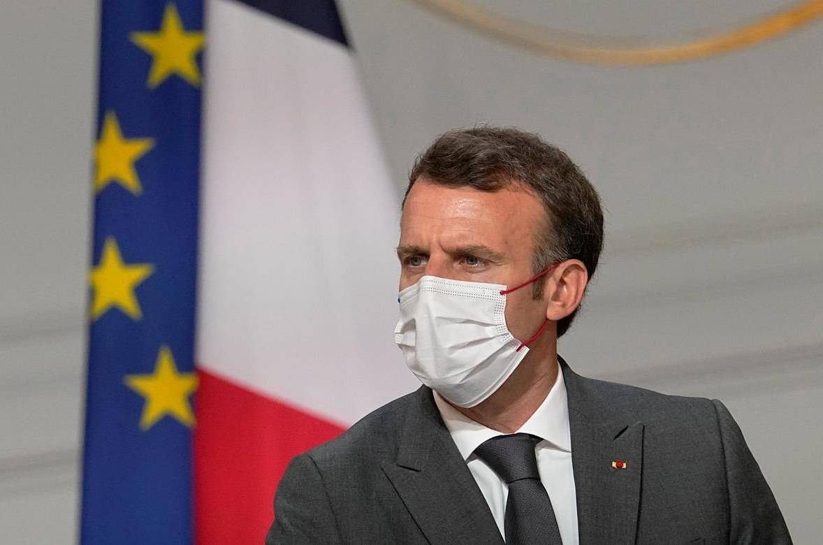 France's President Emmanuel Macron, meets French carmakers at the Elysee Palace in Paris, Monday, July 12, 2021. President Emmanuel Macron is hosting a top-level virus security meeting Monday morning and then giving a televised speech Monday evening, the kind of solemn speech he's given at each turning point in France's virus epidemic.(AP Photo/Michel Euler, Pool)