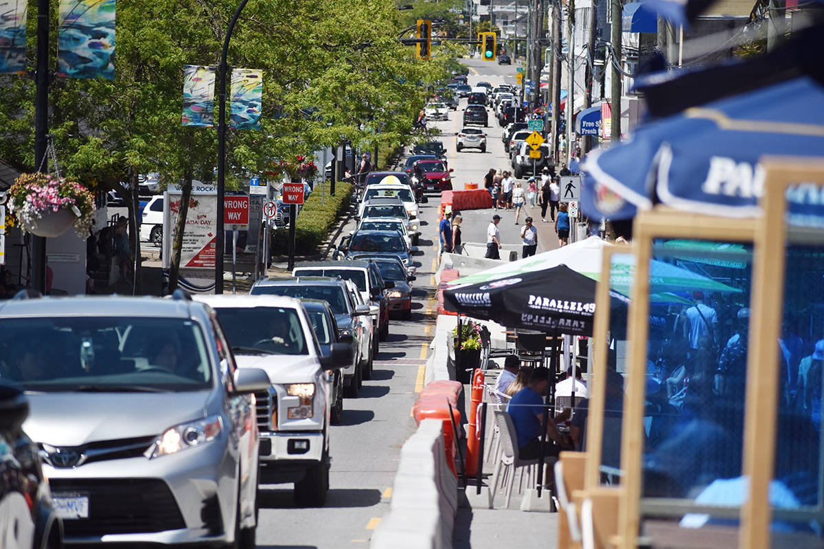 The north lane of White Rock's Marine Drive, closed to westbound traffic since June 7 to provide more patio space for waterfront restaurants, is to reopen by Aug. 7 following a July 12 council vote. (File photo)