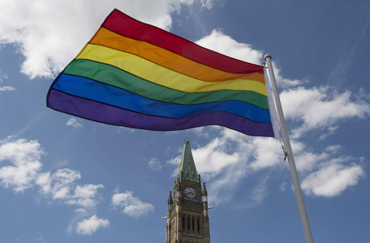 The pride flag flies following a raising ceremony on Parliament Hill Wednesday June 1, 2016 in Ottawa. THE CANADIAN PRESS/Adrian Wyld