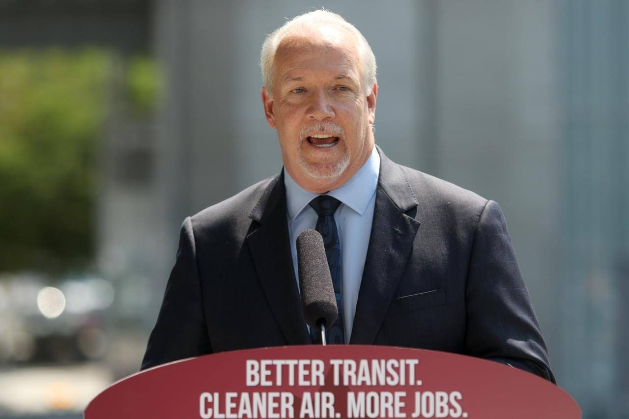 Premier John Horgan talks about the transit announcement at Surrey City Hall in Surrey, B.C., on Friday, July 9, 2021. THE CANADIAN PRESS/Chad Hipolito