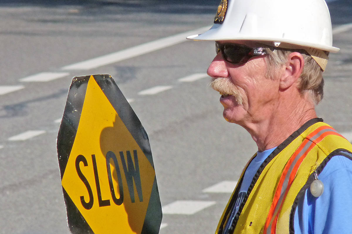 Doug Wells directed traffic in this Langley Advance Times file photo.
