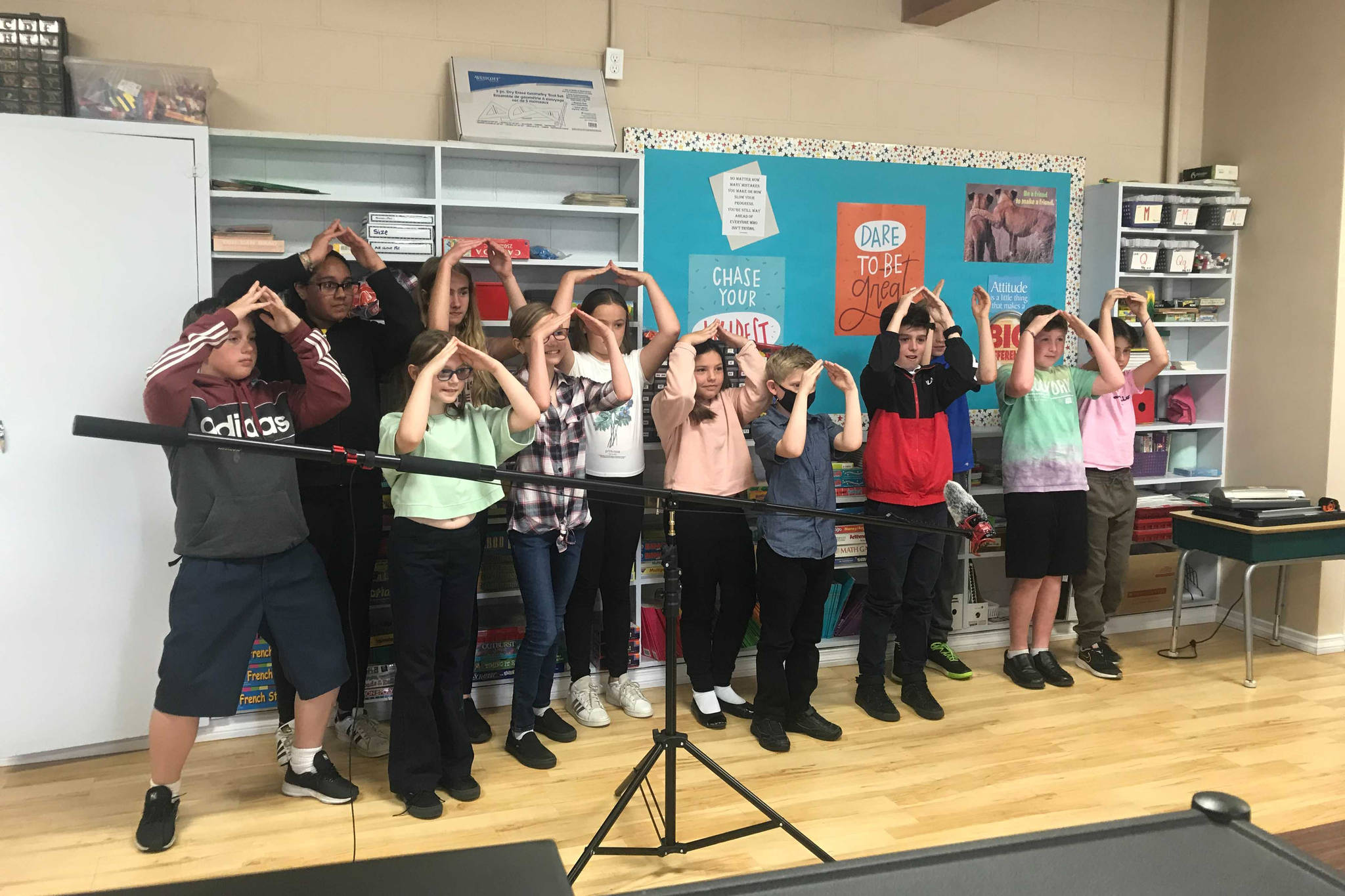 """Students make a """"tiny home"""" sign with their hands as part of the Tiny Home Challenge at John Paul II Catholic School. (ELENA RARDON / ALBERNI VALLEY NEWS)"""