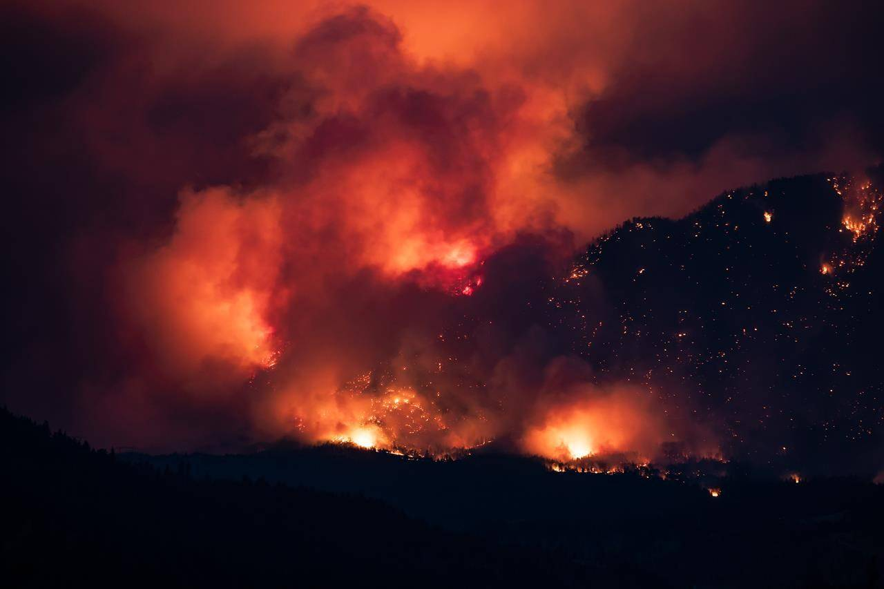 A wildfire burns on the side of a mountain in Lytton, B.C., Thursday, July 1, 2021. THE CANADIAN PRESS/Darryl Dyck