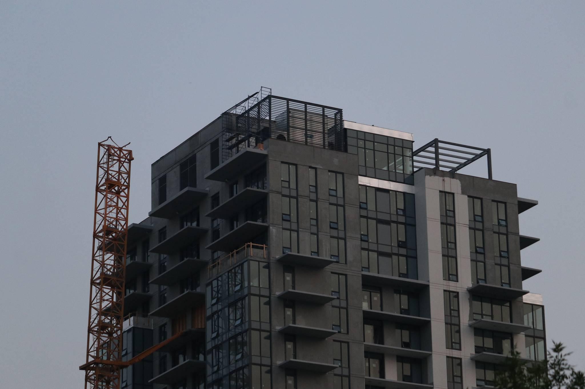 The crane on Tuesday, July 13, before crews began the dismantling process. (Aaron Hemens/Capital News)