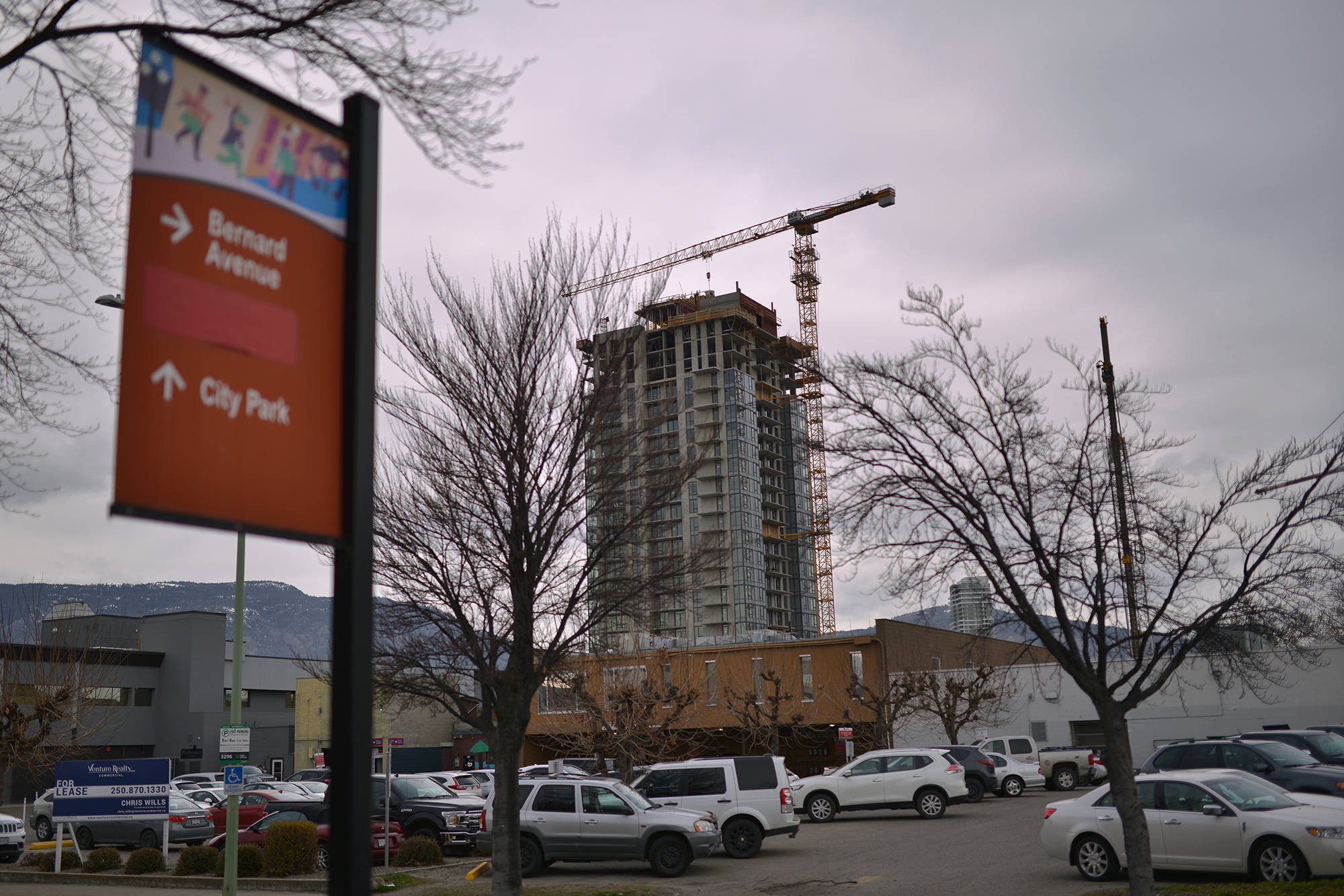 The crane pictured here in operation on March 26, 2021, before it collapsed while being taken down on Monday. (Phil McLachlan/Capital News file photo)