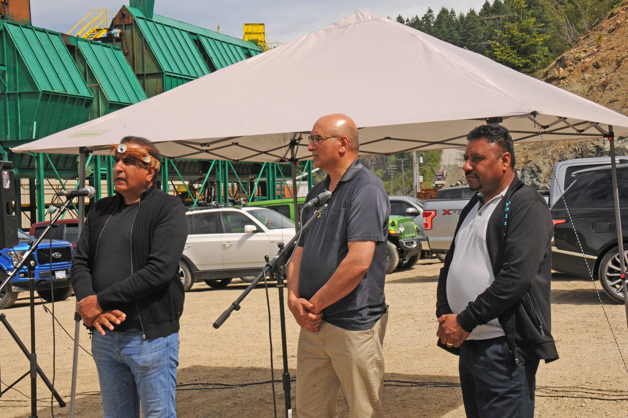 San Group owners Kamal Sanghera, left, Suki Sanghera and Paul Deol (from the Langley operation) announce $100 million in investments in their Port Alberni forestry operations on June 2, 2021. (SUSAN QUINN/ Alberni Valley News)