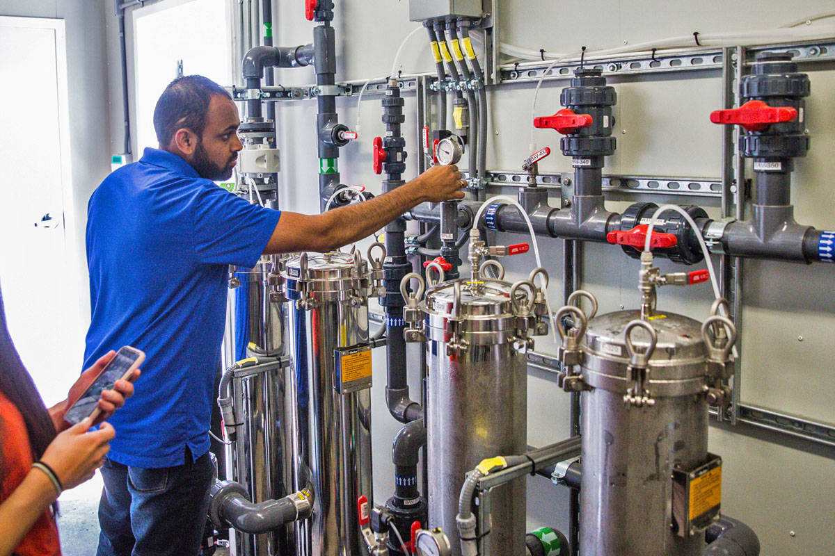 Janish Patel from AWS Water Solutions inspects the equipment. AWS partnered with UBC to provide the water plant. (UBC Submitted Photo)