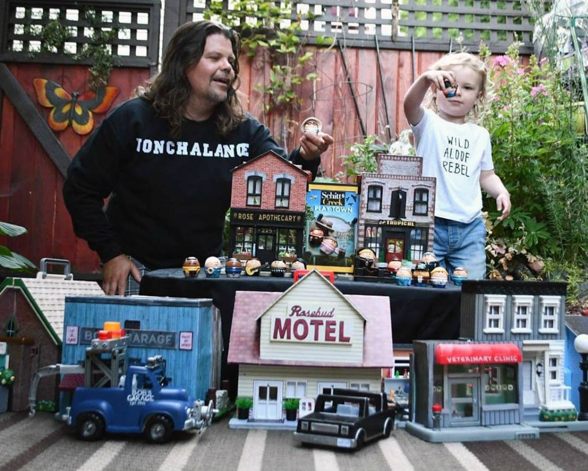 Nanaimo man Todd Cameron and his son Jack play with a miniature replica of Schitt's Creek Cameron made from vintage children's toys. (Photo courtesy Nicole Cameron)