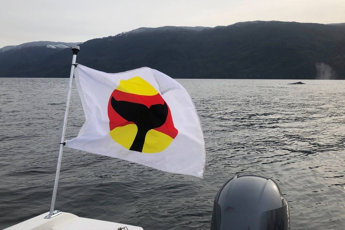 A whale warning flag indicates whales are in the areas and boaters should slow down and change course. Photo courtesy Jackie Hildering.