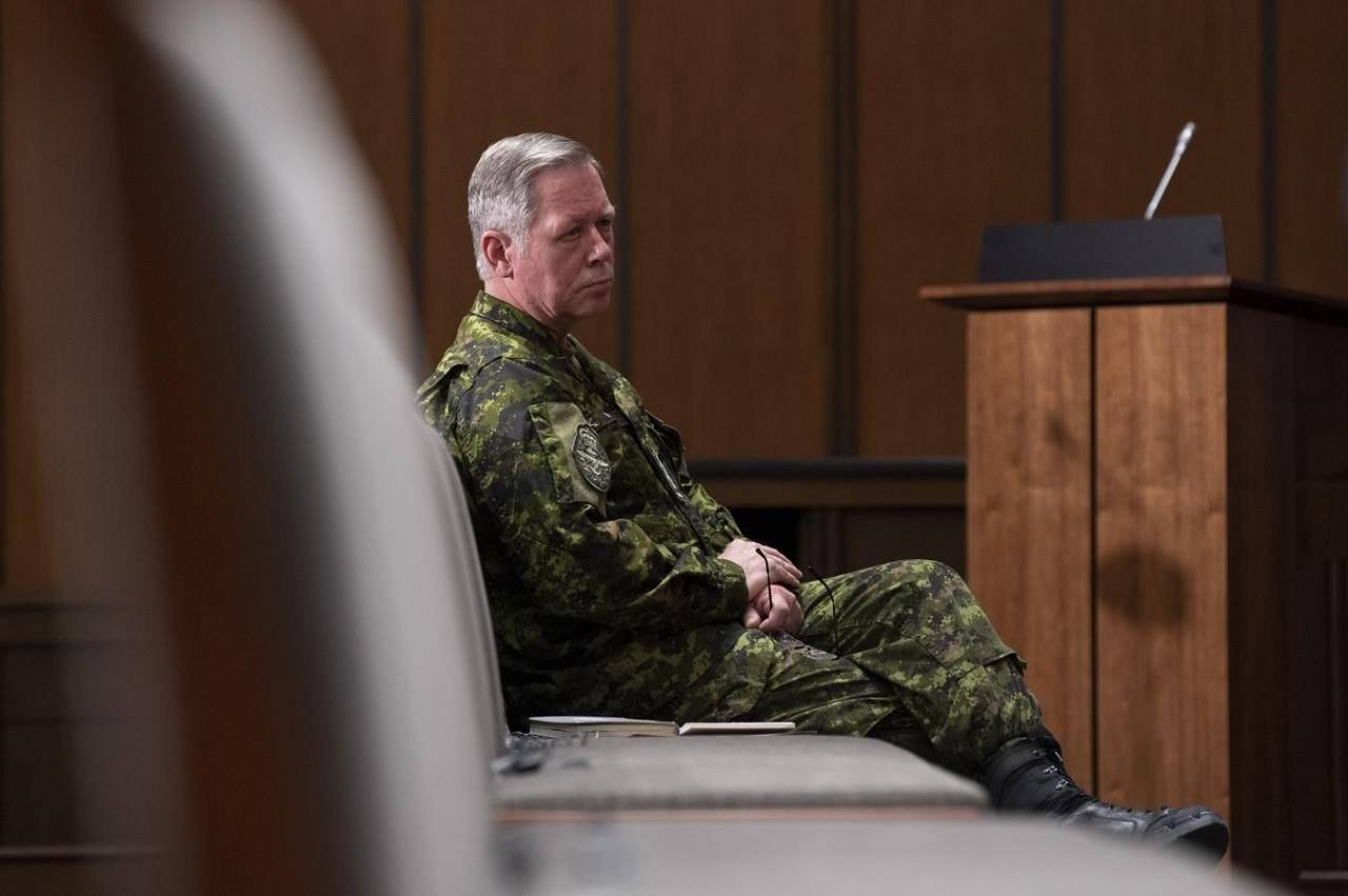 Chief of Defence Staff Jonathan Vance watches a news conference from the front row of seats Thursday May 7, 2020 in Ottawa. Retired general Vance, former chief of the defence staff, has been charged with obstruction of justice.THE CANADIAN PRESS/Adrian Wyld