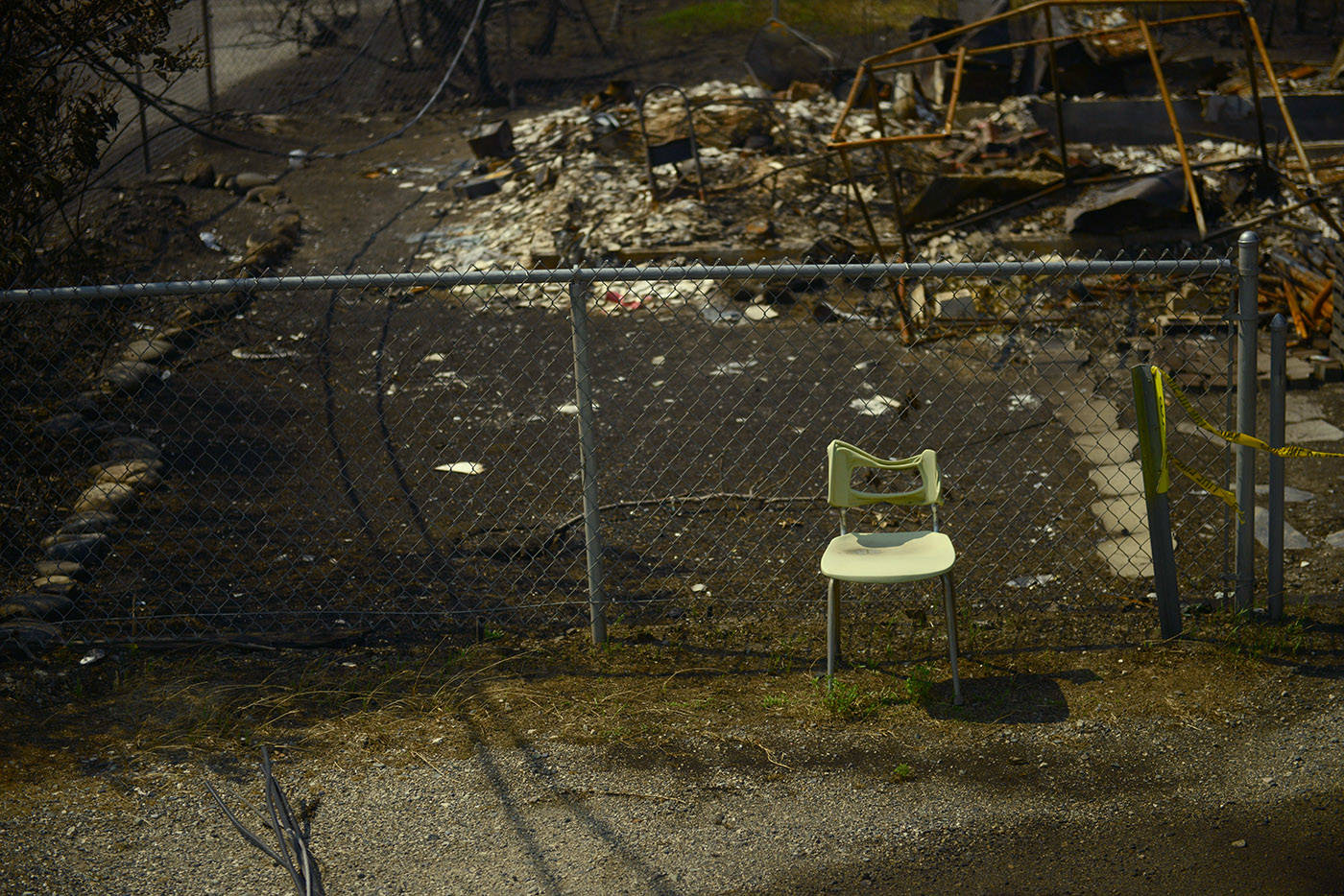 A partially melted chair stands amid the burnt rubble on Main Street in the Village of Lytton, B.C. on Friday, July 9, 2021 following a massive wildfire that tore through the town destroying 90 per cent of it. (Jenna Hauck/ Black Press Media)