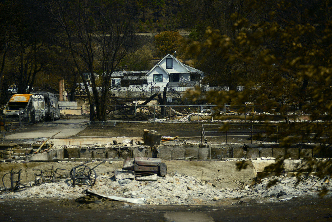 A house stands amid the burnt debris in the Village of Lytton, B.C. on Friday, July 9, 2021 following a massive wildfire that tore through the town destroying 90 per cent of it. (Jenna Hauck/ Black Press Media)