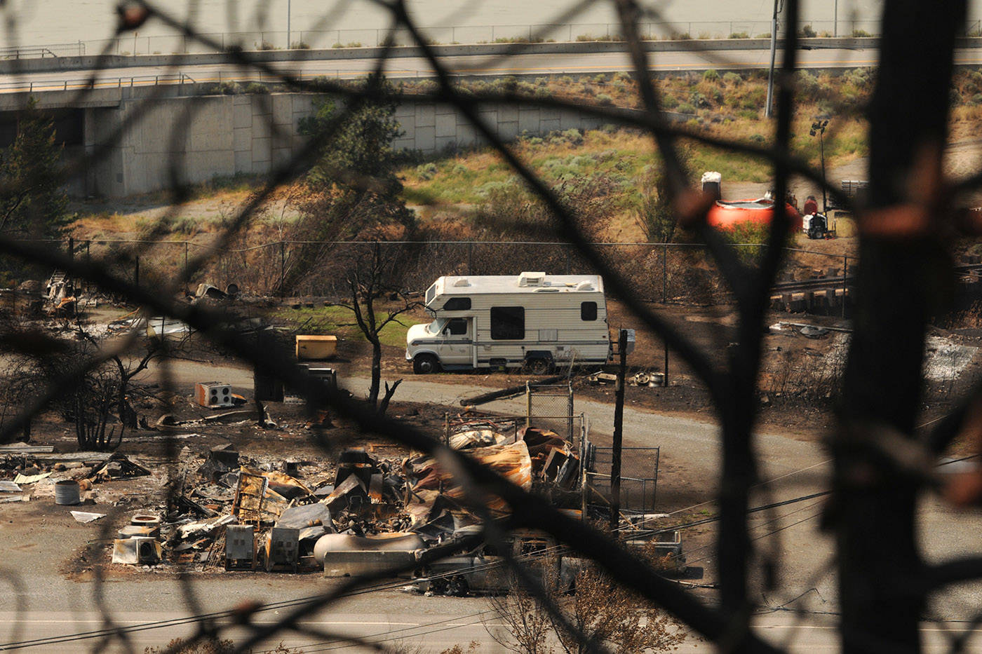 A motorhome sits amid the burnt debris in the Village of Lytton, B.C. on Friday, July 9, 2021 following a massive wildfire that tore through the town destroying 90 per cent of it. (Jenna Hauck/ Black Press Media)