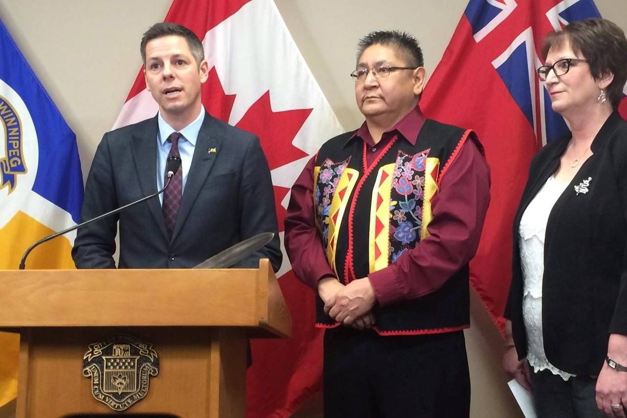 Winnipeg Mayor Brian Bowman, Shoal Lake 40 First Nation Chief Erwin Redsky and Manitoba Indigenous Affairs Minister Eileen Clarke speak to reporters at Winnipeg city hall on Monday Dec. 12, 2016. THE CANADIAN PRESS/Steve Lambert